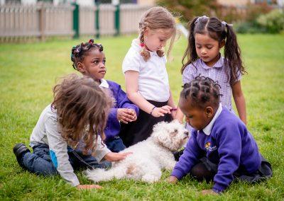 p1077571_children-with-school-dog-on-grass